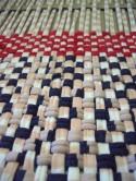 kleiner, gewebter Teppich